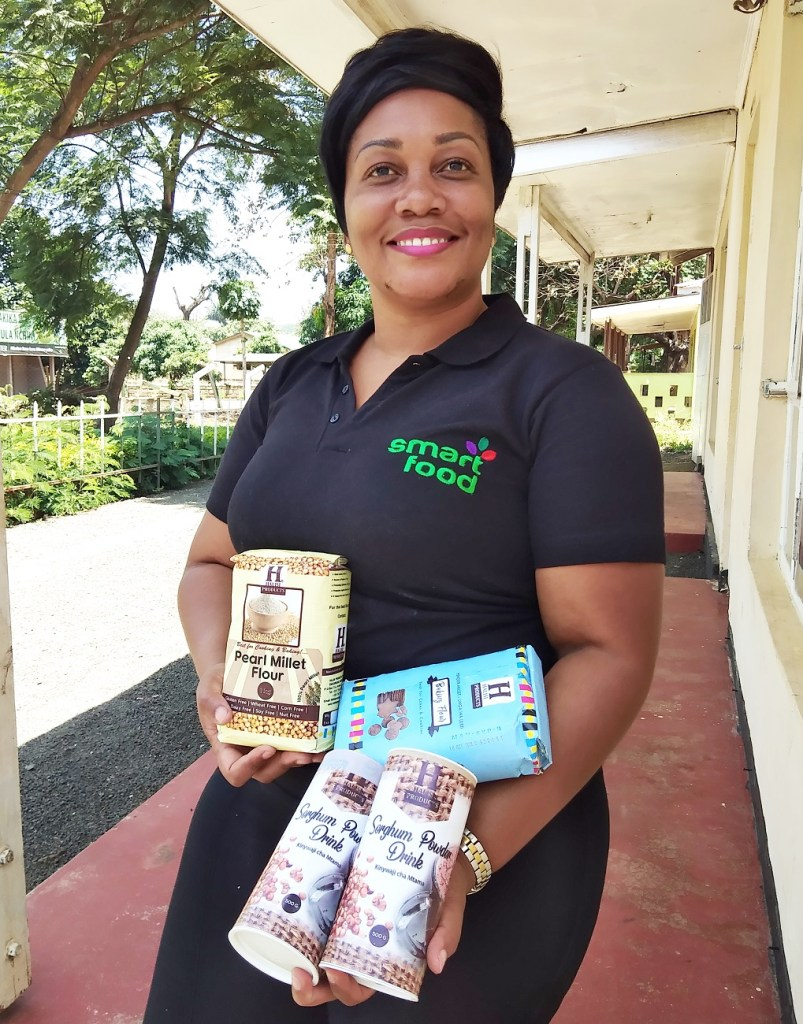 Ms Agatha with her processed sorghum products. Photo: B Jayashree, ICRISAT