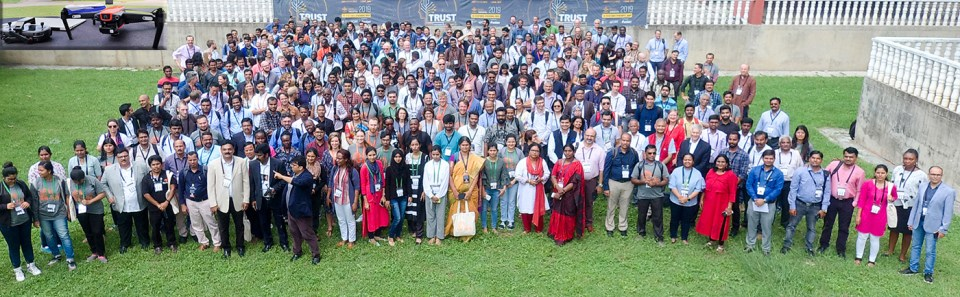 One for the drone: Group photo of the participants taken by an unmanned aerial vehicle (see inset). Photo: Senseacre
