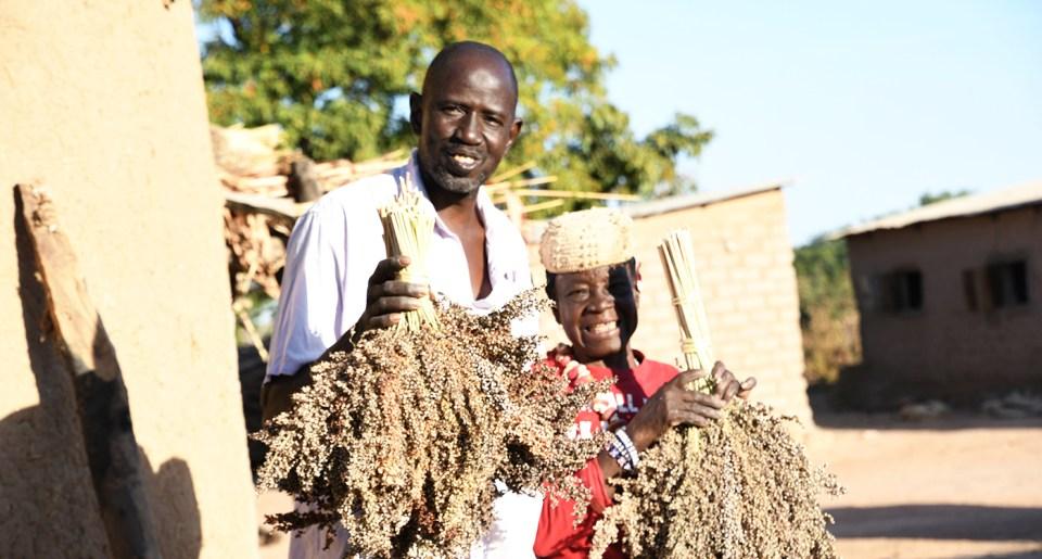 Farmer Bourama Bougodogo with his mother outside their home. Photo: N Diakite and S Touré, ICRISAT