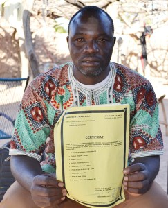 Mr Abdrahamane Bougodogo shows off his certificate of certified seed production.