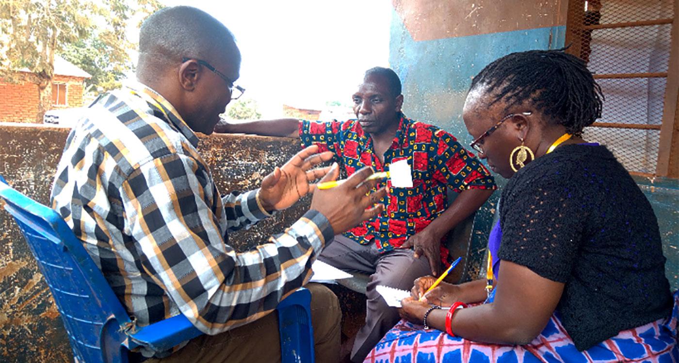 Dr Katindi (right) doing field work.