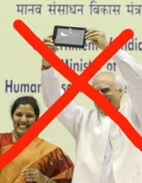 India's Human Resource Development Minister Kapil Sibal displays the supercheap Aakash Tablet computer
