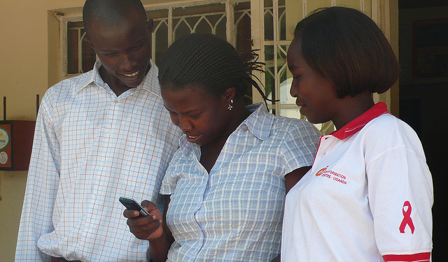 Counselor explaining HIV/AIDS sms quiz (TTCMobile)