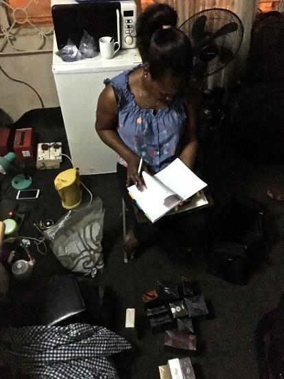 Caroline manages her inventory in her room.