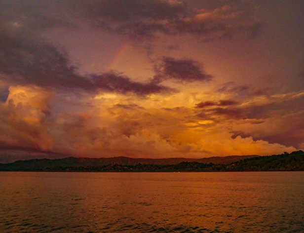 A storm builds at sunset, complete with a rainbow, at the edge of the Térraba watershed.