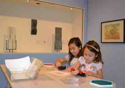 Sisters creating art in Weather or Not exhibit (Medium)