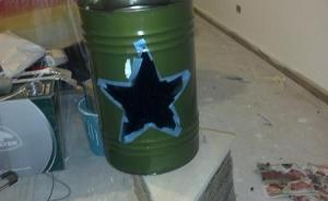 dipingere stella sul bidone di latta