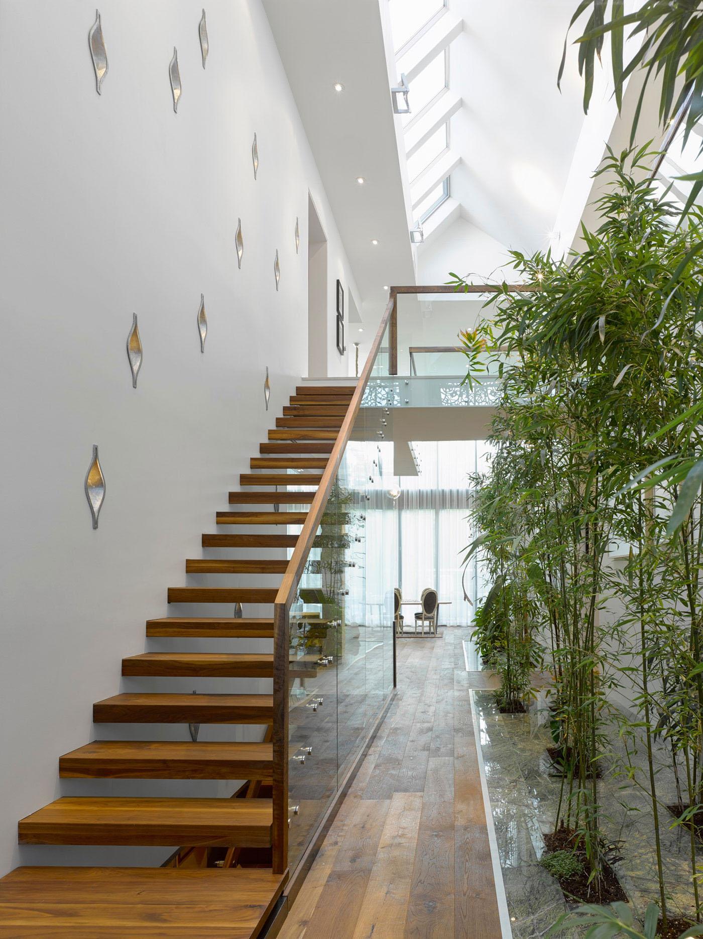 Modern Custom Home With Central Atrium And Interior Bamboo