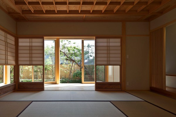 TimberFramed Japanese House Built Around Private Gardens