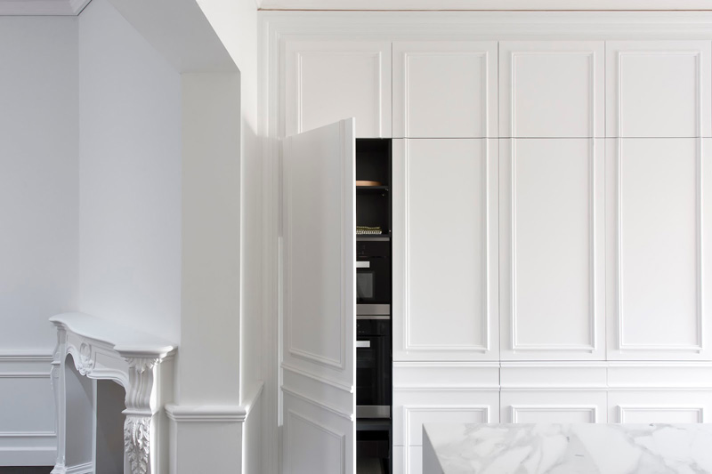 Contemporary Kitchen Hidden Behind Elegant Wall Panels