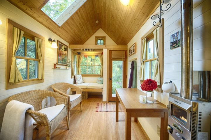 Tiny Houses Bungalow Interior with Wicker Furniture and Dining Table with Flowers Sky Light