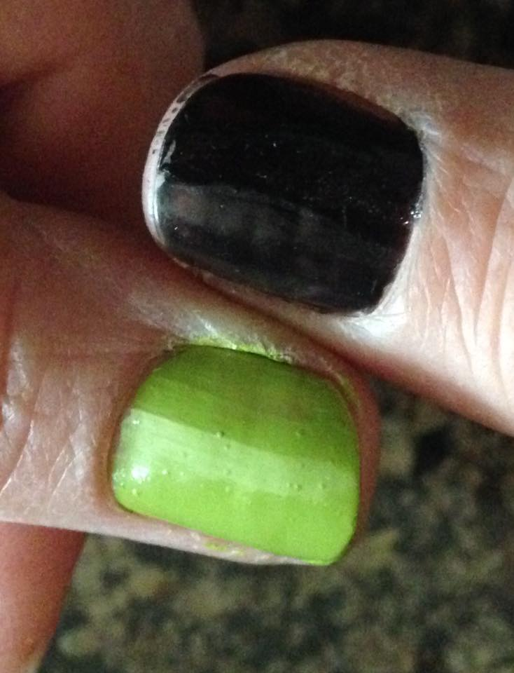 a thumbnail painted green and a thumbnail painted black