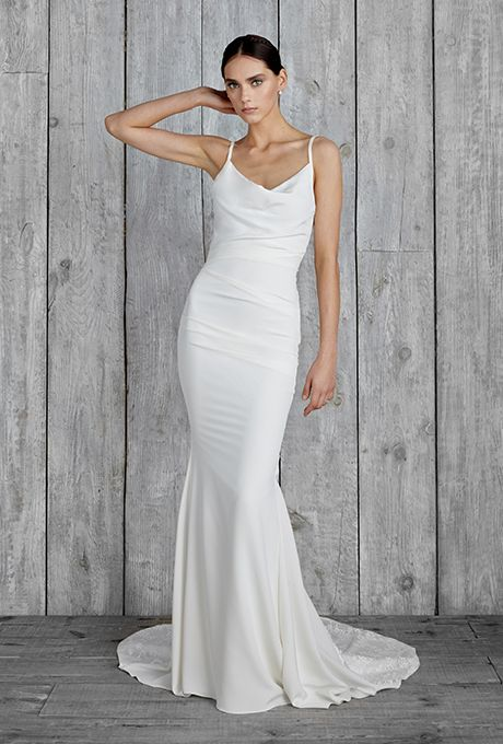 Simple white wedding gowns for your vow renewal bridalpulse slip into something both sensual and womanly with this piece that you can too style in a way that celebrates your own uniqueness junglespirit Choice Image