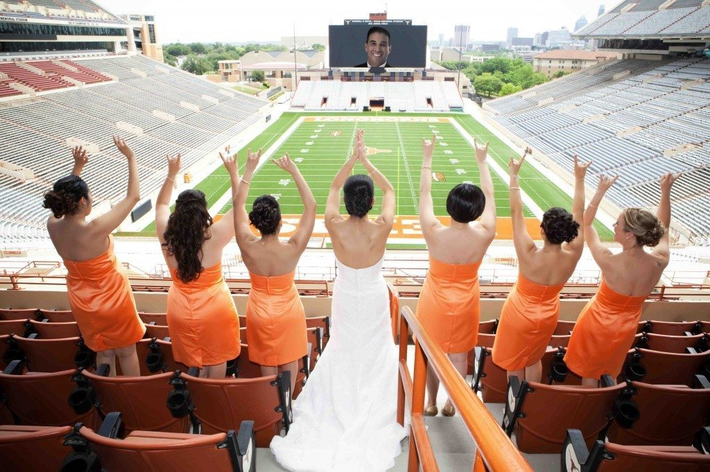 sports-themed-wedding-bridesmaids-wear-orange-bride-wearing-white-wedding-dress.full