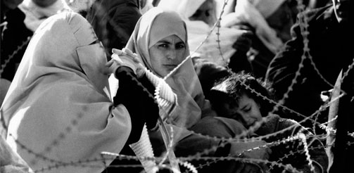 SRAEL (PALESTINE) Gaza Strip. Palestinian women waiting to visit relatives inside Ansar Two prison.