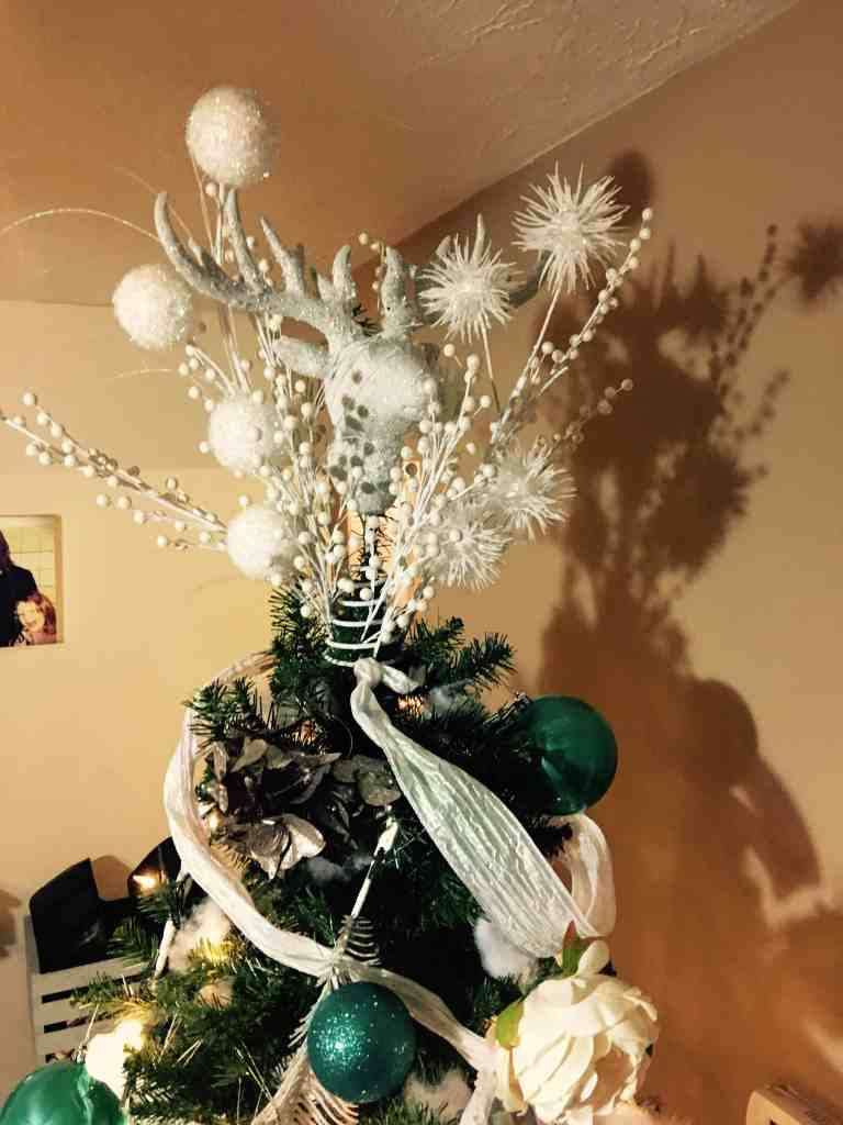 Our glittery deer tree topper + a bunch of other decorations I added to it!