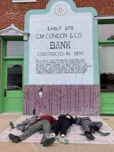 Laying in front of Condon Bank in Coffeyville KS
