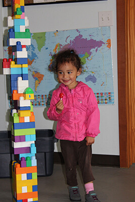 My Grand-Daughter admiring the blocks we built together. Isn't she cute?