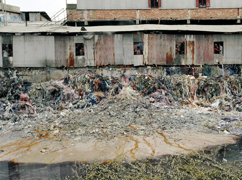 waste products from garment factory spill into stagnant pond