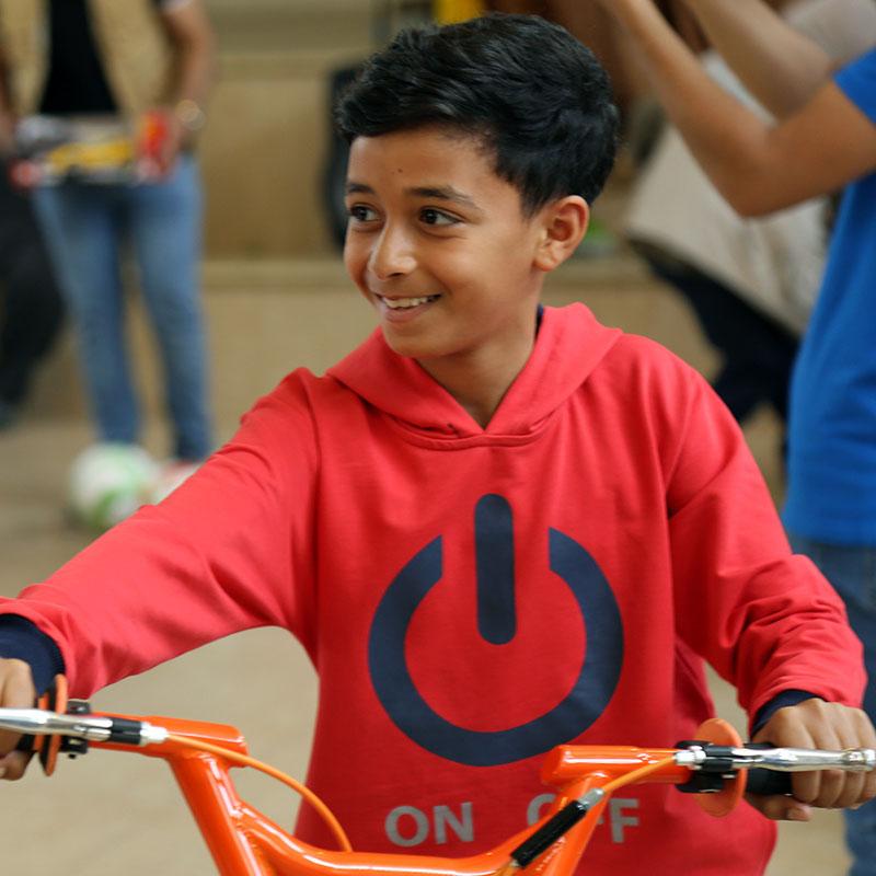 iF Charity - Palestinian Boy - Child on a bike