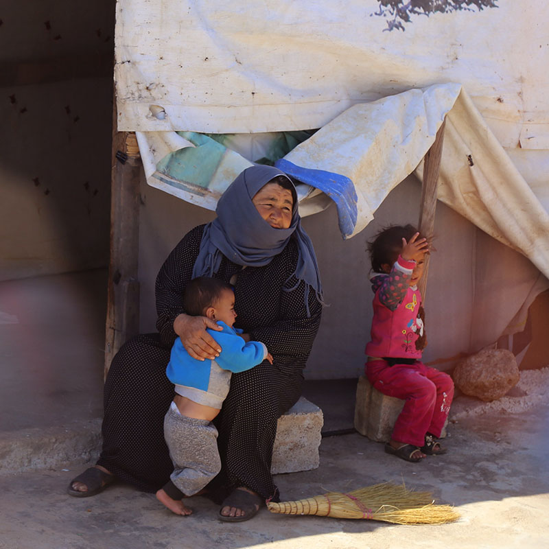 iF Charity - Palestinian woman holding a child