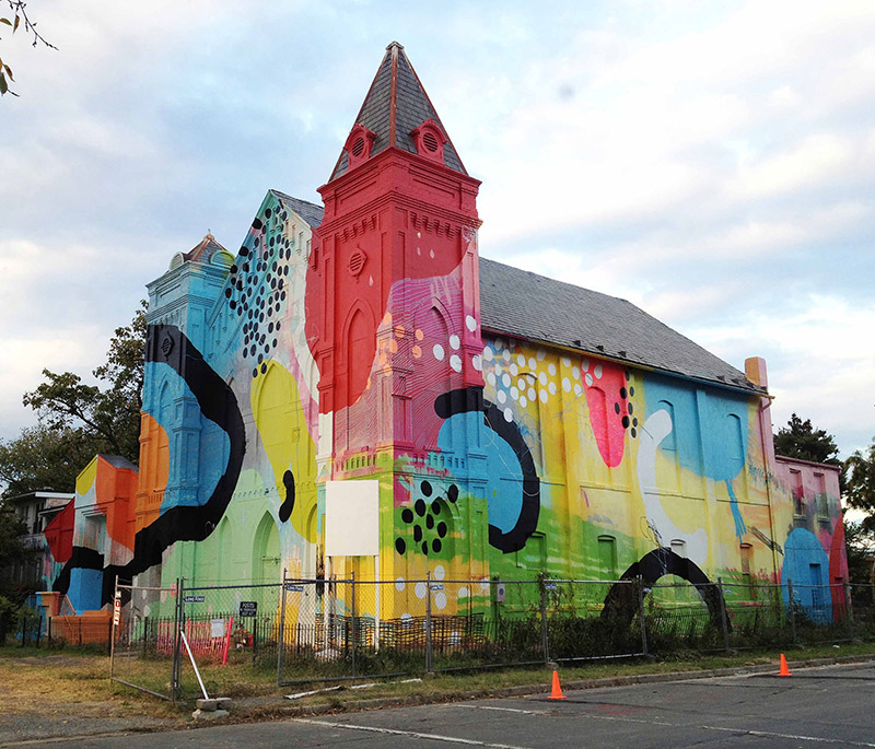 Alex brewer brightens up buildings churches and for Detroit mural factory