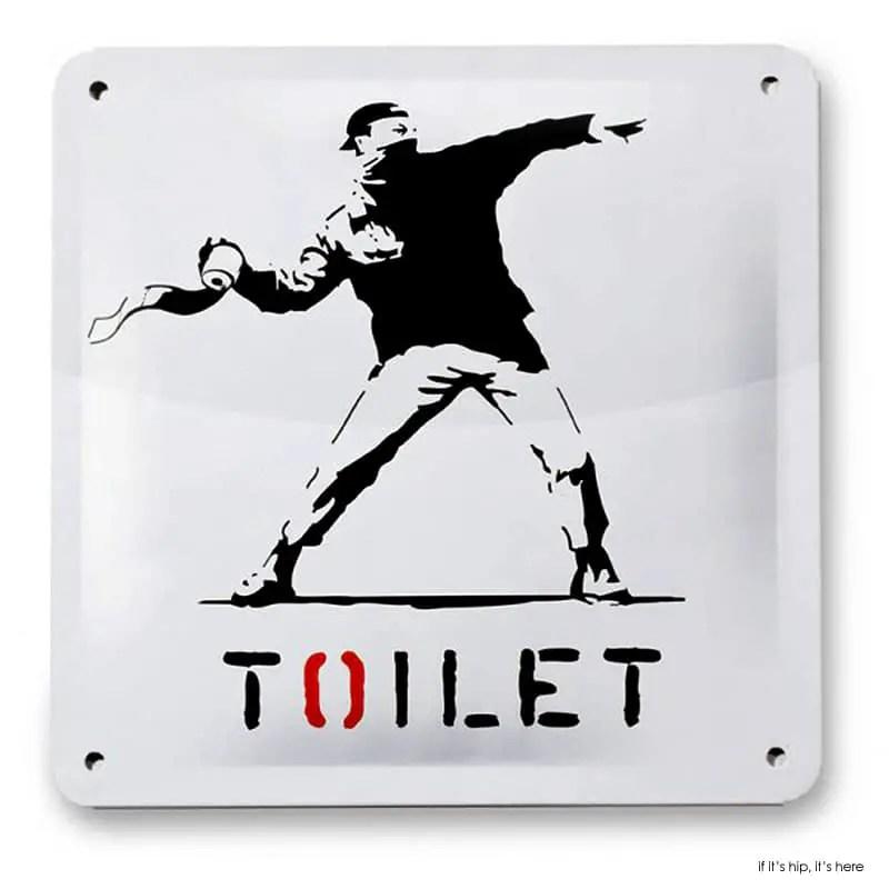 Banksy toilet sign