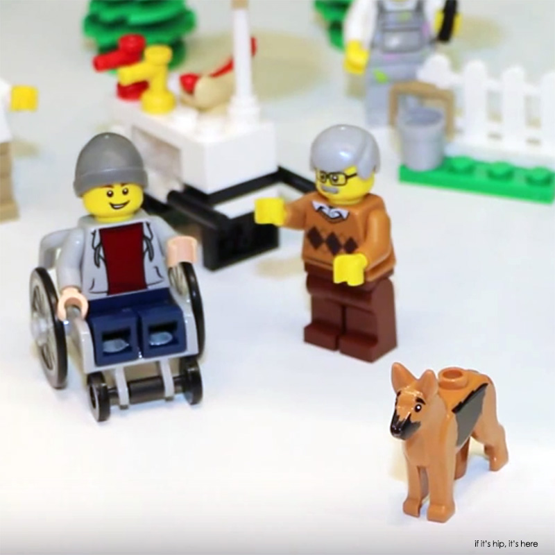 LEGO minifig in wheelchair with assistance dog