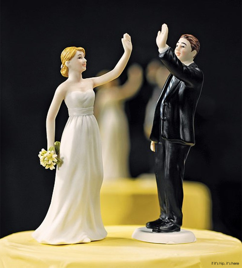 Who in their right mind would want a high-fiving bride and groom cake topper?