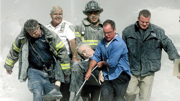 Rescue worker remove fatally injured New York City Fire Department chaplain Rev. Mychal Judge from one of the World Trade Center towers in New York City, early September 11, 2001. REUTERS/Shannon Stapleton
