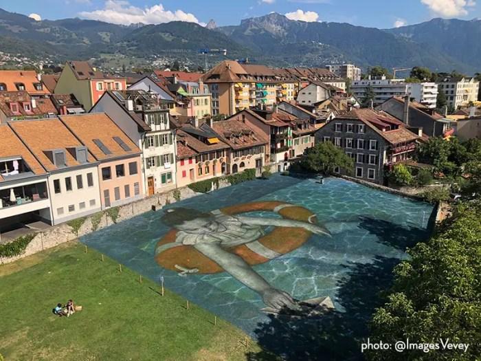 artist saype decorated pool
