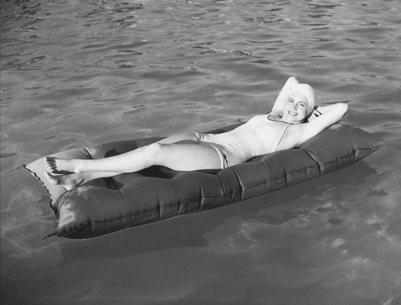 olivia de havilland afloat on a raft