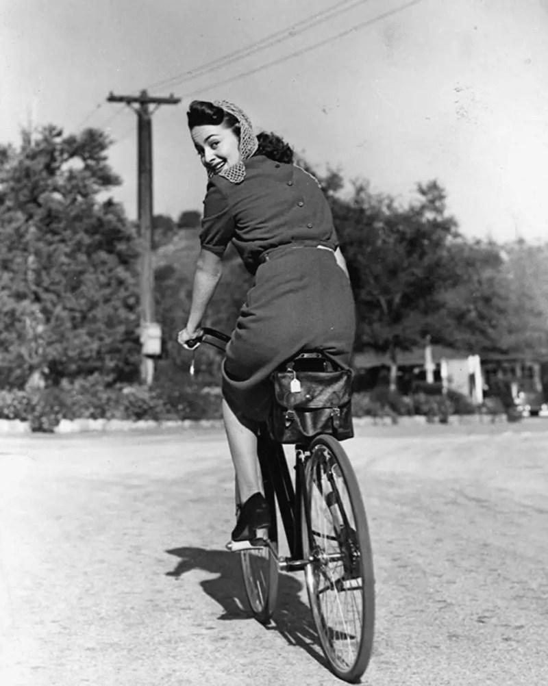 olivia de havilland on bicycle