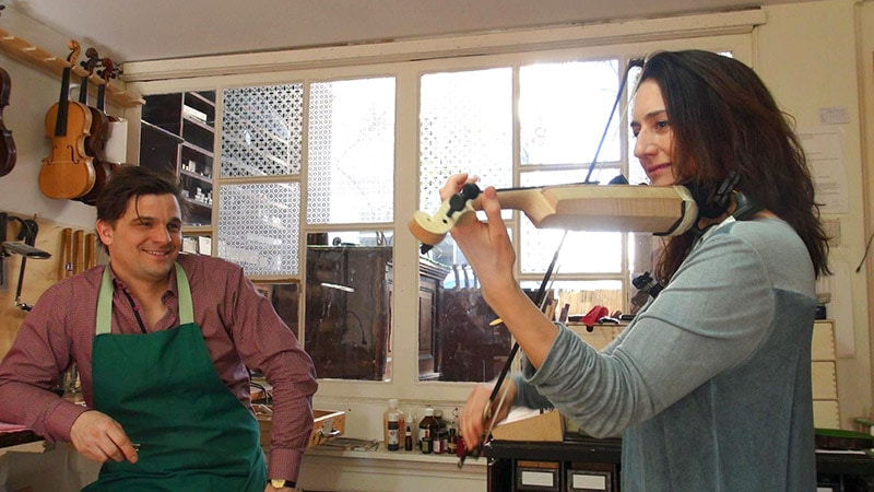 bas maas and monica germino testing out the violin
