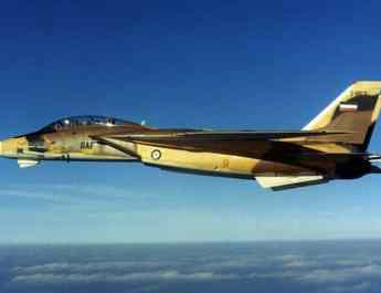 ifmat - Iran says warplanes warned off 2 western vessels during drill