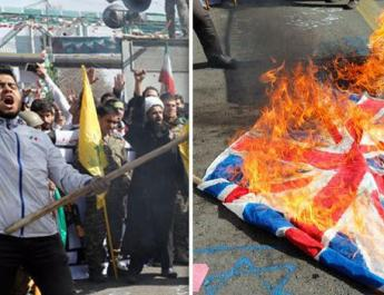 ifmat - British flags set alight in Tehran in chaotic Iran parade