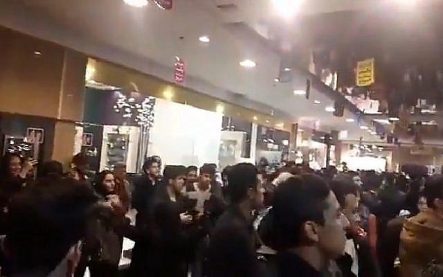 ifmat - Iran arrests official after youths dance at shopping centre concert