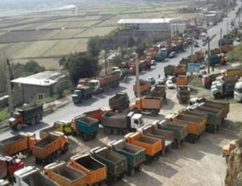 ifmat - Striking truck drivers crippling Iranian regime