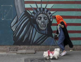 ifmat - Critics howl as Tehran bans dogs