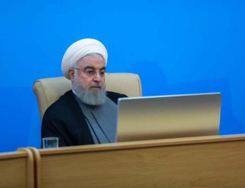ifmat-Iranian president says US sanctions are not impeding fight against coronavirus