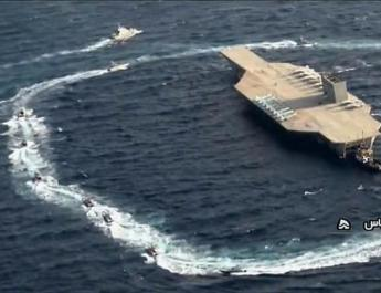 ifmat - Iran criticized after carrying out military exercises against dummy US aircraft carrier