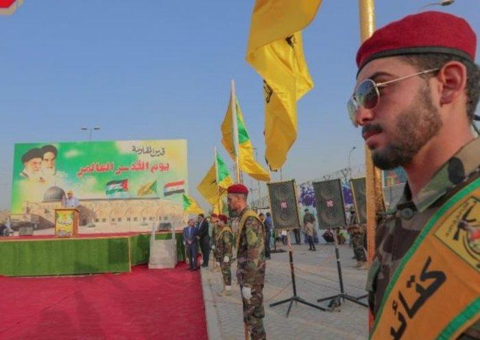 ifmat - Kataib Hizbullah fighters take part in a symbolic ceremony in Baghdad