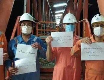 ifmat - 100 Iran oil workers laid off for joining strike