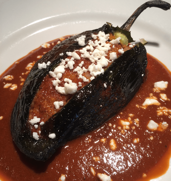 Tamale Stuffed Poblanos with Red Chile Sauce