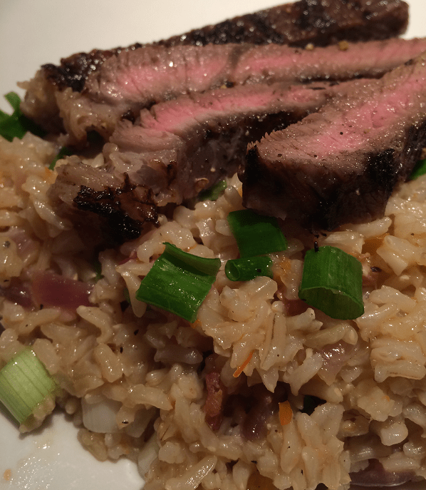 garlic-and-white-habanero-marinated-skirt-steak-over-dirty-rice