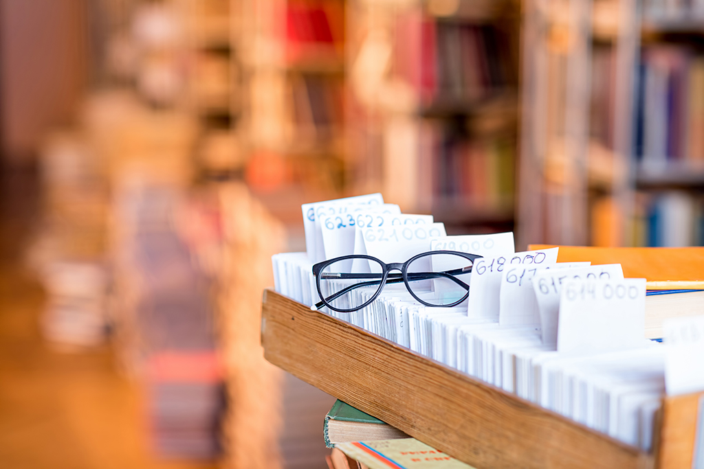card catalog with glasses