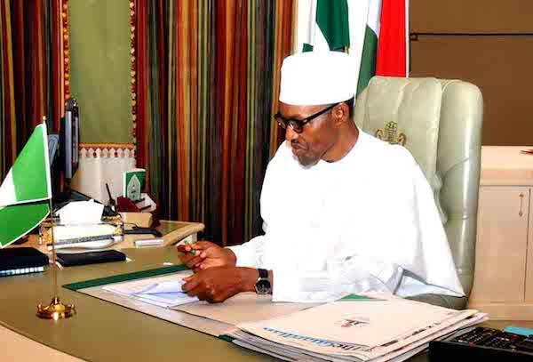 Image result for president Buhari writing