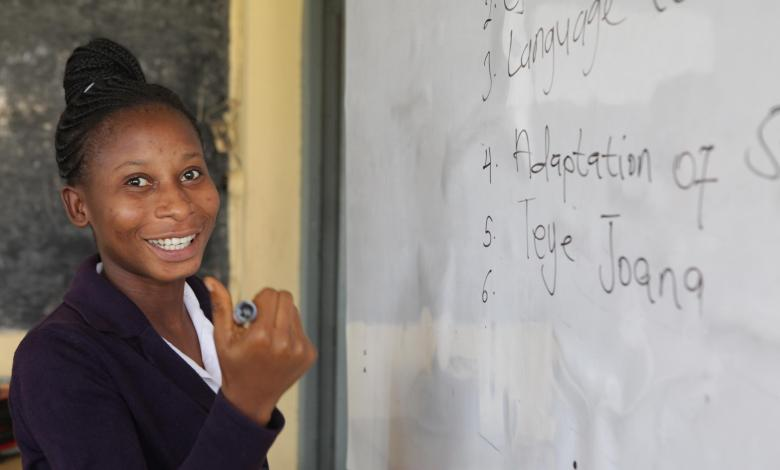 TTEL Student and whiteboard