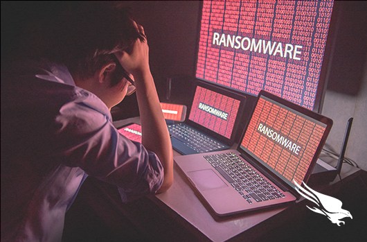 Student Looking At Three Computer Screens With Ransomware