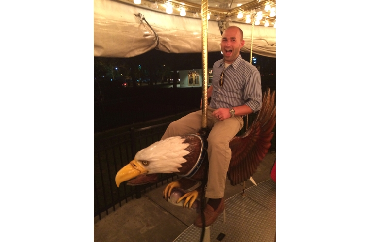 Man on a carousel sitting on an eagle